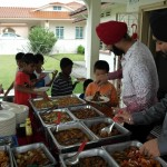 Goldkartz serving the kids during Sewa Day 2