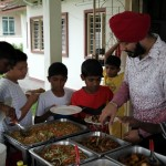 Goldkartz serving the kids during Sewa Day 4